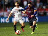 Barcelona's Lionel Messi in action with Sevilla's Wissam Ben Yedder during their La Liga clash on February 23, 2019