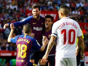 Lionel Messi celebrates scoring Barcelona's first goal against Sevilla in their La Liga clash on February 23, 2019