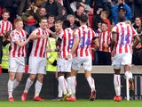 Stoke City's Sam Vokes celebrates with teammates after scoring their first goal on February 23, 2019