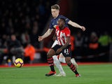 Manchester United midfielder Scott McTominay battles Southampton's Michael Obafemi for the ball in December, 2018