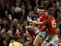 Wales' Josh Adams celebrates with Liam Williams after scoring their second try against England on February 23, 2019