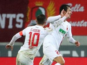 Dortmund suffer title blow as Ji Dong-won downs former club