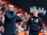Managers Pep Guardiola and Eddie Howe watch on during the Premier League clash between Bournemouth and Manchester City on March 2, 2019