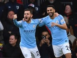 Manchester City's Riyad Mahrez celebrates with Bernardo Silva after opening the scoring against Bournemouth on March 2, 2019