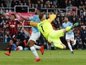 Bournemouth goalkeeper Artur Boruc challenges Manchester City attacker Raheem Sterling during their Premier League clash on March 2, 2019
