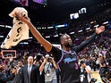 Miami Heat guard Dwyane Wade (3) celebrates after hitting the game winning basket against the Golden State Warriors during the second half at American Airlines Arena on February 28, 2019
