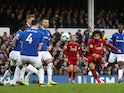 Liverpool forward Mohamed Salah curls a shot on goal during the Merseyside derby meeting with Everton on March 3, 2019