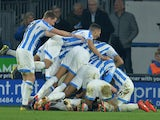 Huddersfield Town players celebrate scoring against Wolves on February 26, 2019