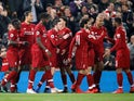 Liverpool players celebrate after scoring against Watford in the Premier League on February 27, 2019