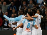 Marseille striker Mario Balotelli celebrates scoring their first goal against Saint-Etienne by taking a selfie with team mates on March 3, 2019