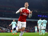 Arsenal midfielder Mesut Ozil celebrates after scoring against Bournemouth in the Premier League on February 27, 2019