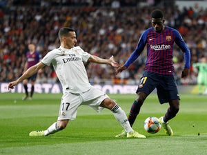 Barcelona's Ousmane Dembele tangles with Real Madrid's Lucas Vazquez in the Copa del Rey on February 27, 2019