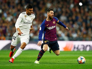 Barcelona's Lionel Messi in action with Real Madrid's Casemiro in the Copa del Rey on February 27, 2019