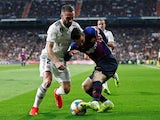 Barcelona's Lionel Messi in action with Real Madrid's Dani Carvajal in the Copa del Rey on February 27, 2019