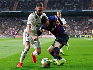 Suarez nets brace as Barca beat Madrid