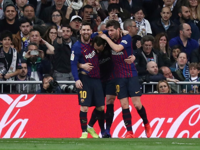 Barcelona players celebrate Ivan Rakitic's opening goal in the Clasico against Real Madrid on March 2, 2019