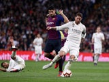 Barcelona's Luis Suarez chases down Real Madrid's Sergio Ramos during El Clasico on March 2, 2019