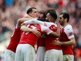 Arsenal players celebrate Aaron Ramsey's opening goal in the North London derby with Tottenham Hotspur on March 2, 2019