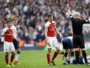 Arsenal midfielder Lucas Torreira is shown a red card during the North London derby with Tottenham Hotspur on March 2, 2019