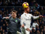 Real Sociedad's Diego Llorente challenges Real Madrid's Sergio Ramos for the ball in January 2019