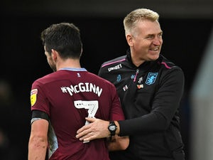 Aston Villa boss Dean Smith embraces midfielder John McGinn in November, 2018