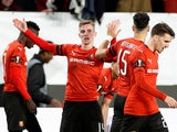 Benjamin Bourigeaud celebrates Rennes going ahead against Arsenal on March 7, 2019
