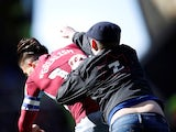 A Birmingham City fan punches Aston Villa midfielder Jack Grealish on March 9, 2019