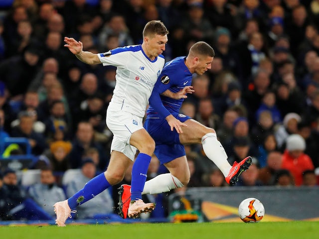 Ross Barkley and Serhiy Sydorchuk in action during the Europa League game between Chelsea and Dynamo Kiev on March 7, 2019)