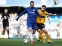 Gonzalo Higuain and Ruben Neves battle for the ball as Chelsea face Wolverhampton Wanderers in the Premier League on March 10, 2019.