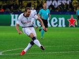 Tottenham Hotspur striker Harry Kane scores against Borussia Dortmund in their Champions League clash on March 5, 2019