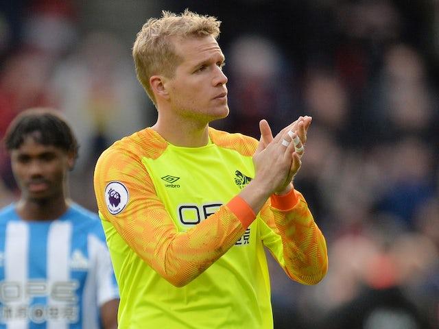 Huddersfield goalkeeper Jonas Lossl: I'm tired of losing
