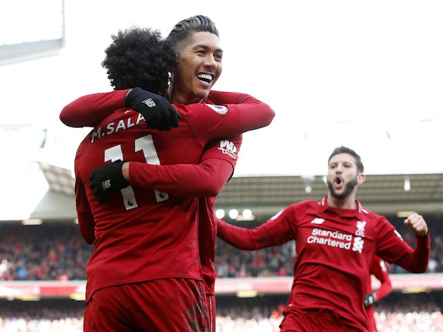 Roberto Firmino celebrates scoring Liverpool's second goal in their Premier League match with Burnley on March 10, 2019.