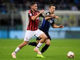 AC Milan's Davide Calabria in action with Inter Milan's Ivan Perisic in their Serie A clash on October 21, 2018