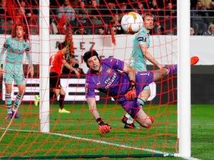 Nacho Monreal scores past Petr Cech during the Europa League game between Rennes and Arsenal on March 7, 2019