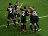 Paris Saint-Germain players celebrate Juan Bernat's goal against Manchester United on March 6, 2019