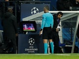 Referee Damir Skomina watches the VAR monitor during the Champions League game between Paris Saint-Germain and Manchester United on March 6, 2019