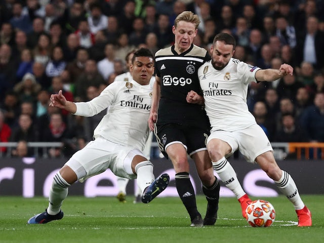 Ajax's Frenkie de Jong tangles with Real Madrid pair Dani Carvajal and Casemiro in the Champions League on March 5, 2019