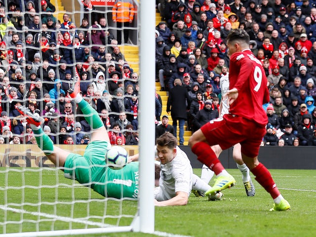 Roberto Firmino scores Liverpool's first goal in their Premier League match with Burnley on March 10, 2019.