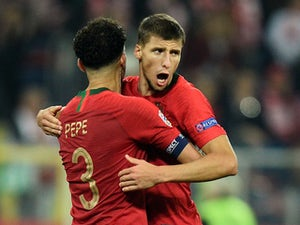Benfica's Ruben Dias celebrates with Portugal teammate Pepe in the UEFA Nations League in October, 2018