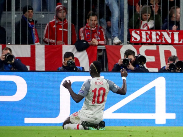 Sadio Mane celebrates after opening the scoring for Liverpool in their Champions League tie with Bayern Munich on March 13, 2019