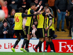 Watford's Andre Gray celebrates scoring their second goal with Troy Deeney during their FA Cup quarter-final with Crystal Palace on March 16, 2019