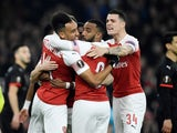 Pierre-Emerick Aubameyang celebrates with his Arsenal teammates after opening the scoring against Rennes on March 14, 2019