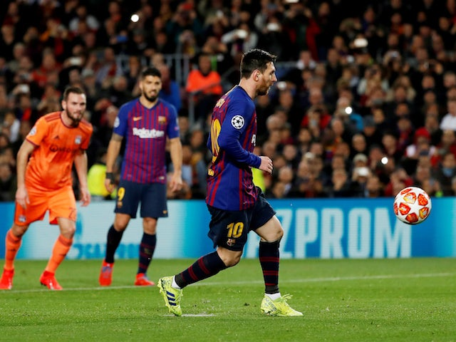 Barcelona's Lionel Messi scores from the penalty spot against Lyon in the Champions League on March 13, 2019