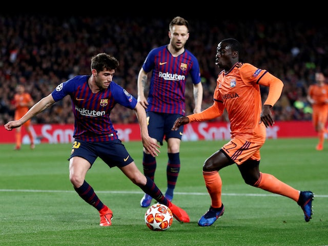 Barcelona's Sergi Roberto tangles with Lyon's Ferland Mendy in the Champions League on March 13, 2019