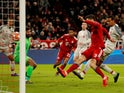 Liverpool defender Joel Matip sticks the ball into his own net in the Champions League tie with Bayern Munich on March 13, 2019