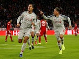 Virgil van Dijk celebrates with Roberto Firmino after scoring Liverpool's second goal against Bayern Munich on March 13, 2019