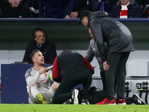 Liverpool captain Jordan Henderson receives treatment for an ankle injury against Bayern Munich on March 13, 2019