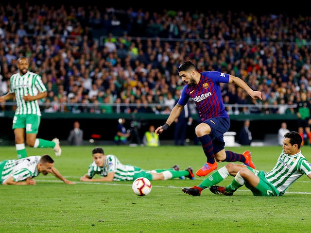 Barcelona's Luis Suarez leaves Real Betis defenders in his wake as he scores on March 17, 2019