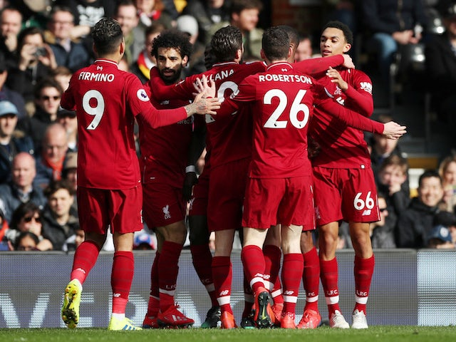 Sadio Mane celebrates with teammates after opening the scoring for Liverpool against Fulham on March 17, 2019