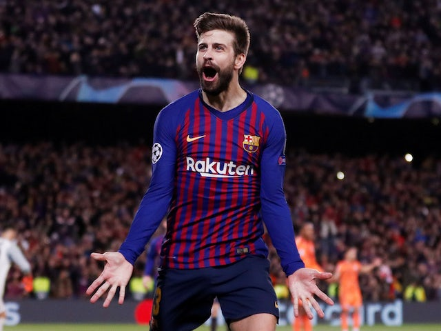 Gerard Pique celebrates scoring for Barcelona on March 13, 2019